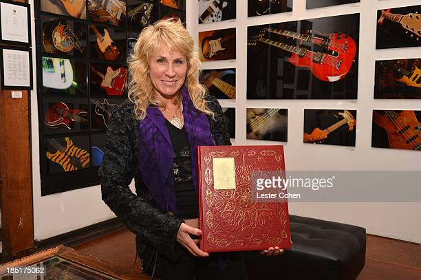 Photographer/author Lisa S Johnson attends '108 Rock Star Guitars' book release at Mr Musichead Gallery on October 17 2013 in Los Angeles California