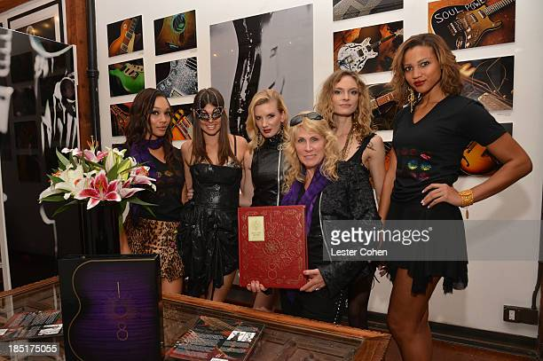 Photographer/author Lisa S Johnson with models during '108 Rock Star Guitars' book release at Mr Musichead Gallery on October 17 2013 in Los Angeles...