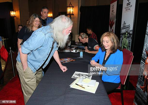 Photographer/author Rory Flynn signs books for a fan during day three of the 2015 TCM Classic Film Festival on March 28 2015 in Los Angeles...