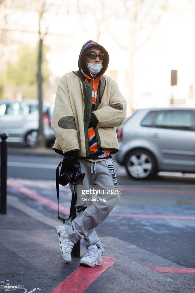 Photographer/Designer Youngjun Koo wears NUMBER (N)INE sunglasses, a vintage reversible jacket, Vetements sweatpants, and Nike Air shoes on January 21, 2016 in Paris, France.
