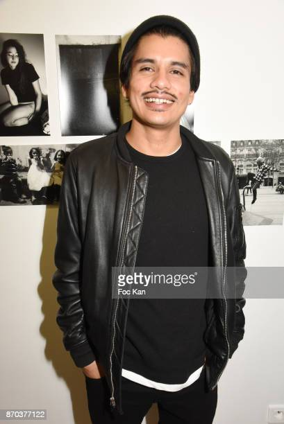 Photographer/musician Jonathan Velasquez pose with his personal work during the Larry Clark and Jonathan Velasquez Photo Exhibition as part of Larry...