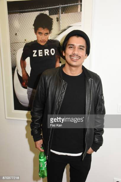 Photographer/musician Jonathan Velasquez poses with his portraits by Larry Clark during the Larry Clark and Jonathan Velasquez Photo Exhibition as...