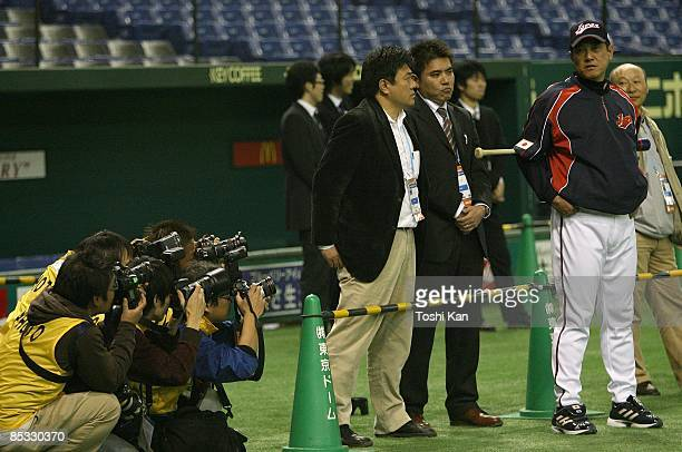 Photographers aim their cameras at Tatsunori Hara Manager of the Japanese team during a workout before the 2009 World Baseball Classic on Wednesday...