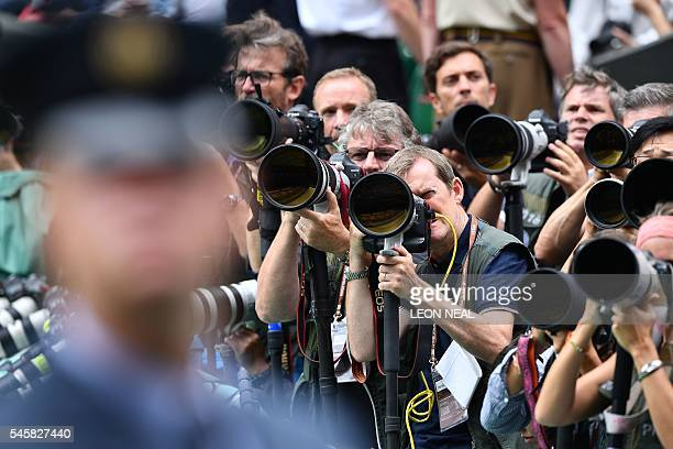 Photographers aim their lenses at the royal box on centre court before the men's singles final match on the last day of the 2016 Wimbledon...