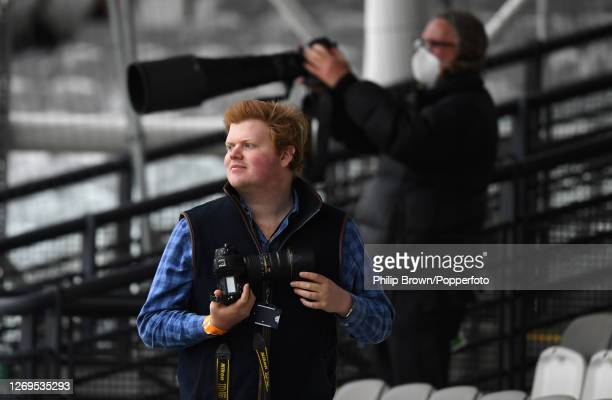 Photographers Alex Davidson of Getty and Matt Bright look on during the T20 Vitality Blast match against Kent Spitfires at Lord's Cricket Ground on...