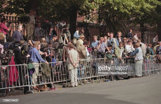 Photographers and camera operators gather behind a security barrier outside Manor House on Prince William's first day at Eton College in Eton,...
