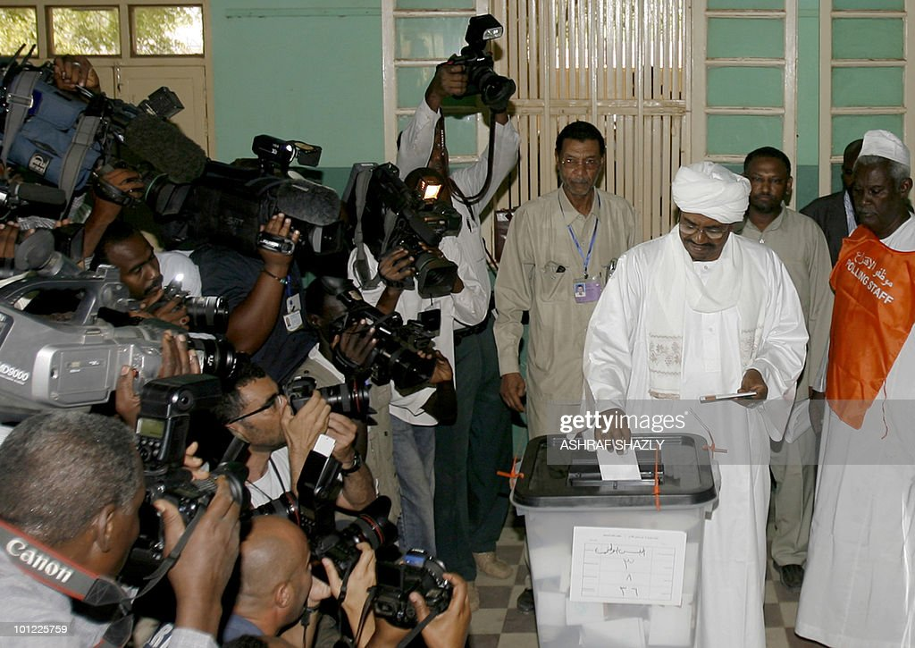 Photographers and cameramen photograph Sudanese President Omar al-Beshir as he votes at a polling station in Khartoum on April 11, 2010. Beshir, who is virtually guaranteed re-election in a three-day vote that began on April 11, is a career soldier with Islamist leanings accused of war crimes by the International Criminal Court.
