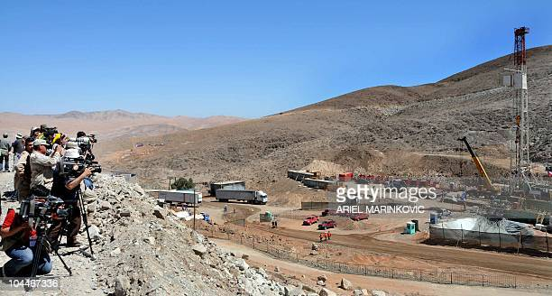 Photographers and cameramen take images from the rescue operation area on September 26 in San Jose mine near Copiapo 800 km north of Santiago Chile A...