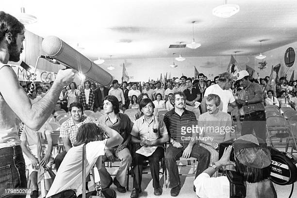 Photographers and film crew members document a United Farm Workers press conference 1977 Pictured are labor activists Eliseo Medina unidentified...