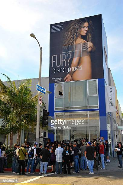 Photographers and onlookers surround the scene as TV personality Khloe Kardashian unveils her PETA Fur I'd Rather Go Naked billboard on December 10...