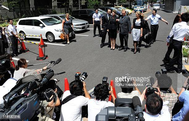 Photographers and other media crowd behind cones as the family of slain 22-year-old British teacher Lindsay Ann Hawker, mother Julia father Bill, ,...