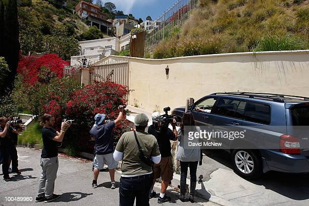 Photographers and reporters look on as people arrive at the home of Simon Monjack after he was found dead by his motherinlaw on May 24 2010 in...