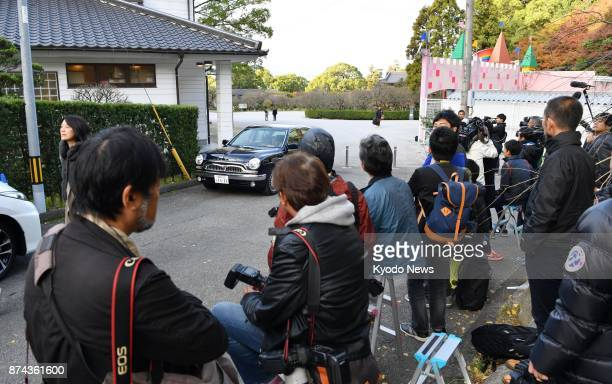 Photographers and reporters wait in front of the Isegahama sumo stable's lodgings in Dazaifu Fukuoka Prefecture southwestern Japan on Nov 15 a day...
