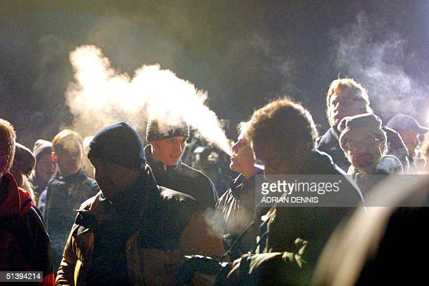 Photographers and television crews gather outside Skibo Castle in freezing weather awaiting news about Madonna and Guy Ritchie's wedding 22 December...
