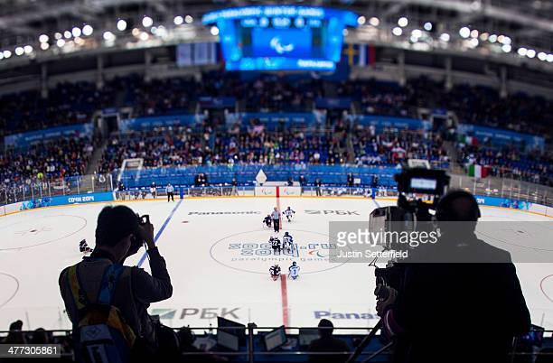 Photographers and TV camera's look on at the start of the Ice Sledge Hockey Preliminary Round Group A match between the United States of America and...