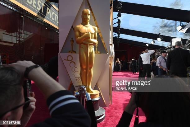 Photographers and TV crews get ready on the red carpet a few hours before the 'Oscars' the 90th Annual Academy Awards on March 4 in Hollywood...
