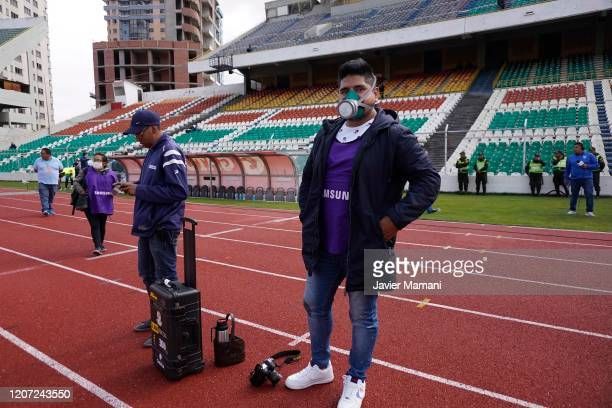 Photographers are required to use any type of protection to prevent the expansion of the coronavirus during a match between Bolivar and Wilstermann...
