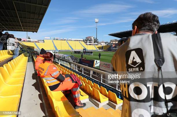 Photographers are seen in an empty stadium during the Serie A match between Parma Calcio and SPAL at Stadio Ennio Tardini on March 8 2020 in Parma...