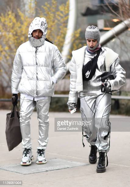 Photographers are seen wearing silver outfits outside the Proenza Schouler show during New York Fashion Week Fall/Winter 2019 on February 11 2019 in...