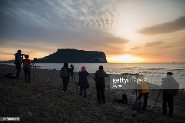 photographers at the beach - jeju stock photos and pictures