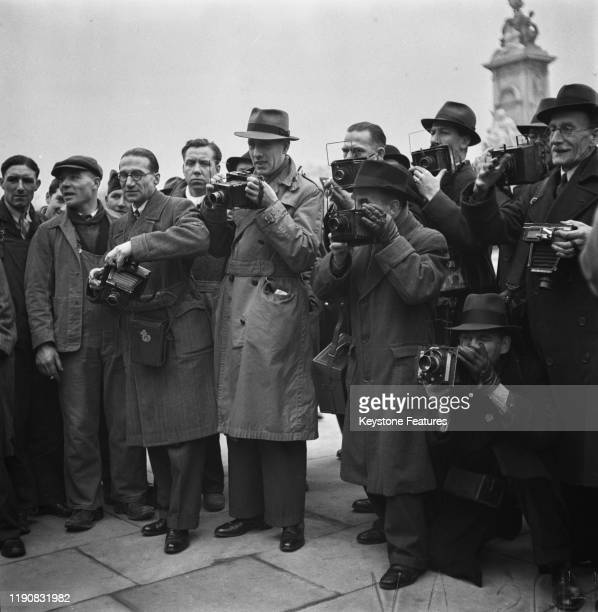 Photographers at the gates of Buckingham Palace in London on Investiture Day during World War II, April 1941.