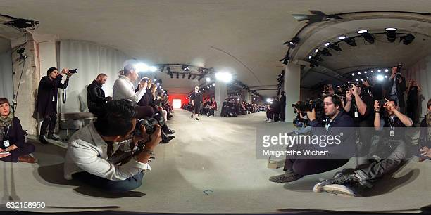 Photographers at work while a model walks the runway at the DEPRESSION show during the MercedesBenz Fashion Week Berlin A/W 2017 at Kaufhaus Jandorf...