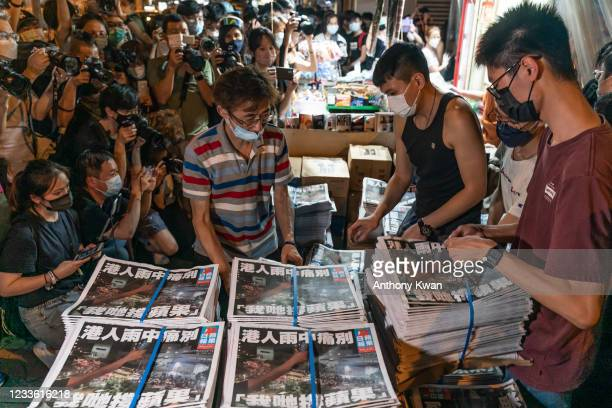 Photographers attend as the final issue of the Apple Daily newspaper was delivered to a newspaper stands on June 24, 2021 in Hong Kong, China. The 26...