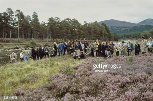 Photographers await the arrival of Prince Charles and Diana, Princess of Wales for a photocall by the River Dee at the end of their honeymoon at...