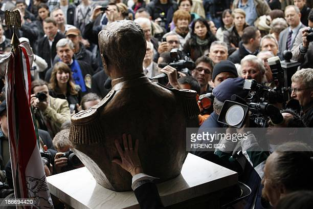 Photographers cameramen and visitors crowd around a statuebust of Hungary's wartime leader Miklos Horthy after it was unveiled in Budapest on...