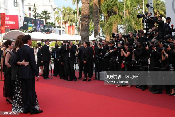 Photographers capture Director of the Cannes Film Festival Pierre Lescure Patrice Forest of Idem Paris Executive producer Sabrina S Sutherland Emily...