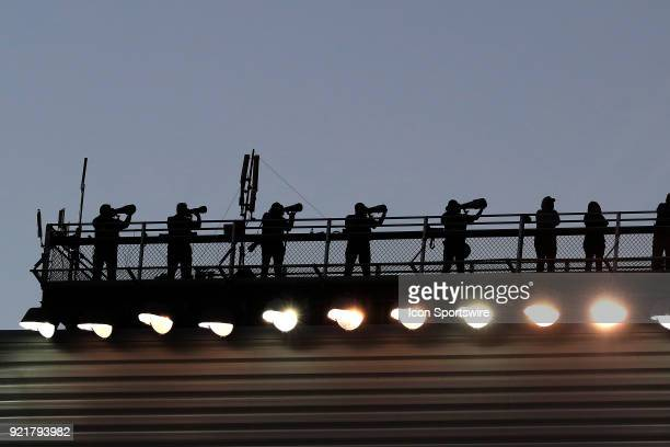 Photographers capture the race action from the roof during the 60th running of the Daytona 500 on February 18 at the Daytona International Speedway...