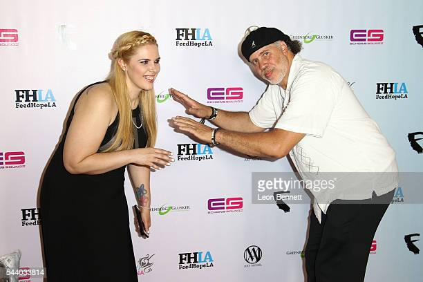 Photographers Cassy Athena and Arnold Turner attends the EMotion Art Show on June 30 2016 in Los Angeles California