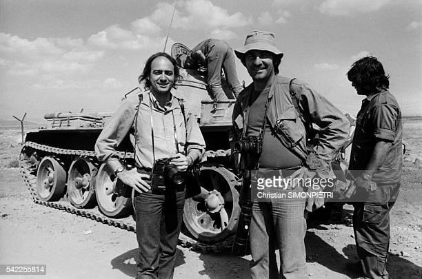 Photographers Christian Simonpietri and Henri Bureau in front of an Israeli tank near Kuneitra | Location Near Kuneitra Golan Heights