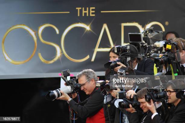 Photographers cover the red carpet arrivals to the 85th Annual Academy Awards at the Hollywood & Highland Center on February 24, 2012 in Hollywood,...