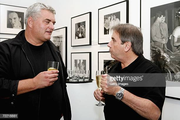 Photographers Dave Hogan and Tom Stoddart speak at a Blake 7 function at the Getty Images Gallery on October 18, 2006 in London, England. They later...