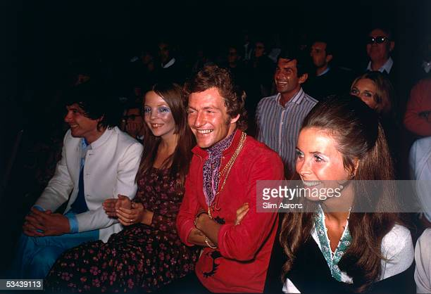 Photographers David Bailey and Patrick Earl of Lichfield sit on either side of model Penelope Tree in Capri September 1968 Behind them is actor...