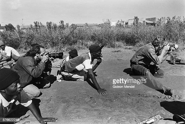 photographers documenting gun battle in south africa - photojournalist stock pictures, royalty-free photos & images