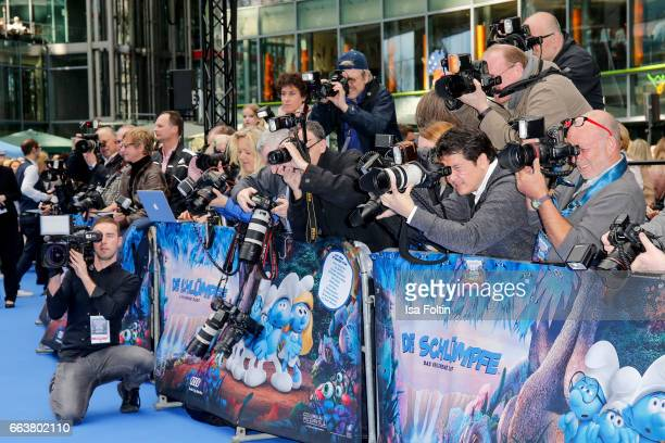 Photographers during the 'Die Schluempfe Das verlorene Dorf' premiere at Sony Centre on April 2 2017 in Berlin Germany