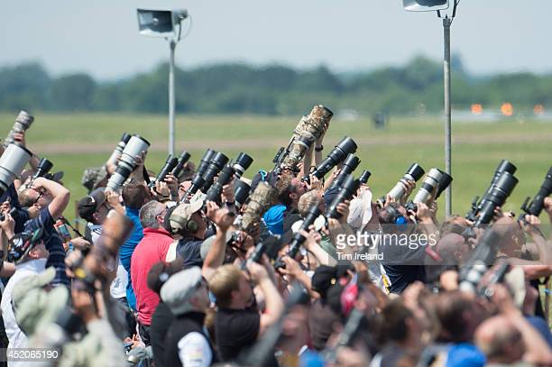 Photographers enjoy the show during the Royal International Air Tattoo at RAF Fairford on July 12, 2014 in Fairford, England. The Royal International...