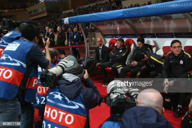 Photographers focus in on Pep Guardiola the coach of Manchester City ahead of the UEFA Champions League Round of 16 second leg match between AS...
