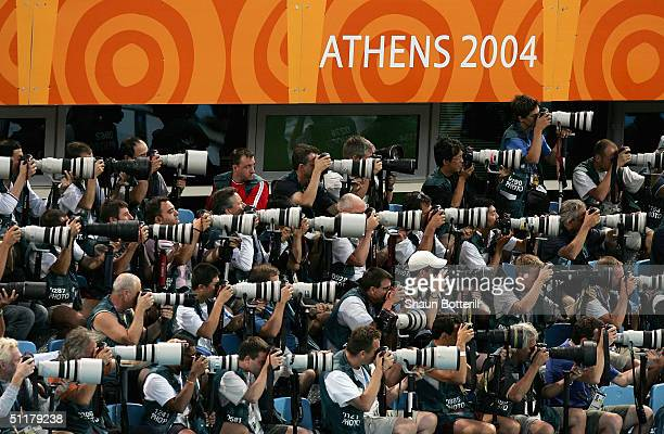 Photographers focus on the action on August 16 2004 during the Athens 2004 Summer Olympic Games at the Main Pool of the Olympic Sports Complex...