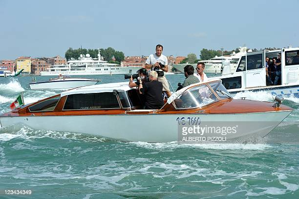 Photographers follow the boat carrying actors Matt Damon, Gwyneth Paltrow and Laurence Fishburne on their way to the 68th Venice Film Festival on...