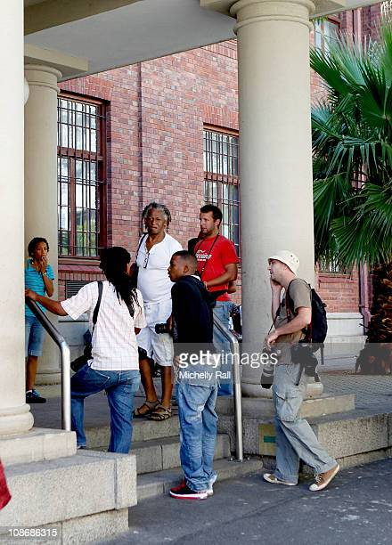 Photographers gather at the entrance to Cape Town Magistrates Court sign where Lady Amelia Spencer was due to appear on charges for common assault on...