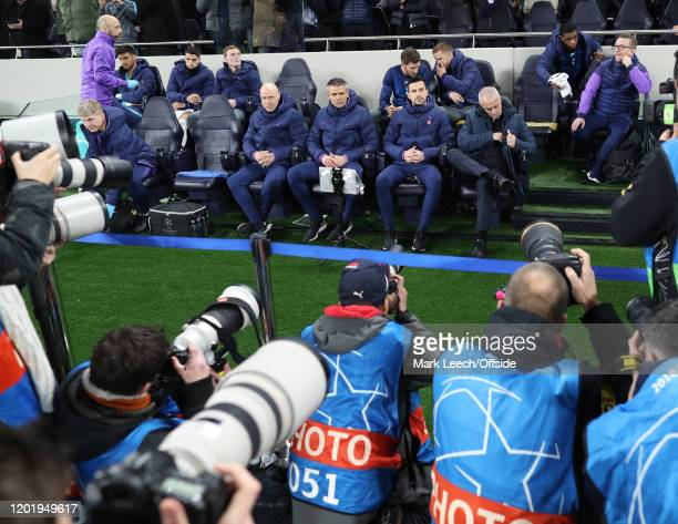 photographers gather in front of Tottenham manager Jose Mourinho prior to the UEFA Champions League round of 16 first leg match between Tottenham...