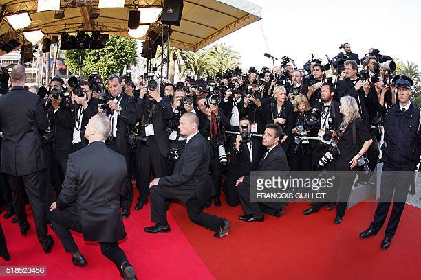 Photographers gather on the red carpet as guests arrive to attend the screening of US director Steven Spielberg's film 'Indiana Jones and the Kingdom...