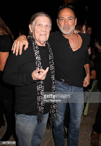 Photographers Henry Diltz and Timothy White at iconic rock photographer Danny Clinch exhibition opening at Morrison Hotel Gallery on October 23 2014...