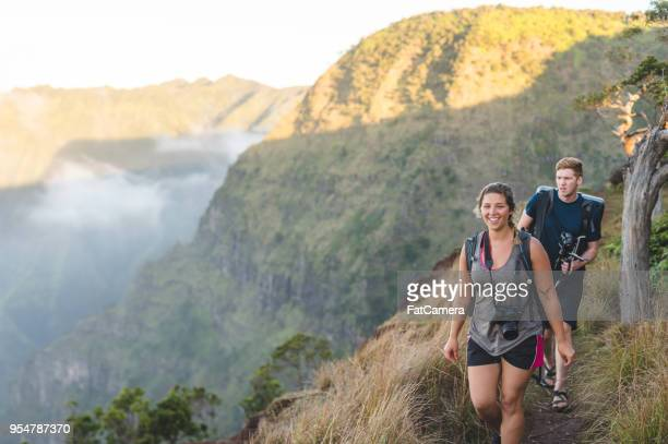 photographers hiking up hawaii mountain - state park stock pictures, royalty-free photos & images