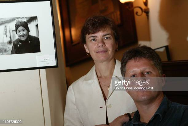 Photographers Ian Masterton and Ulana Switucha exhibit their photos of Hakka villagers which were taken in Guangdon at the China Tee Club 31 May 2003