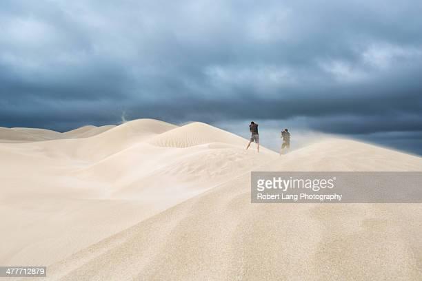 Photographers in wild sand dunes, South Australia