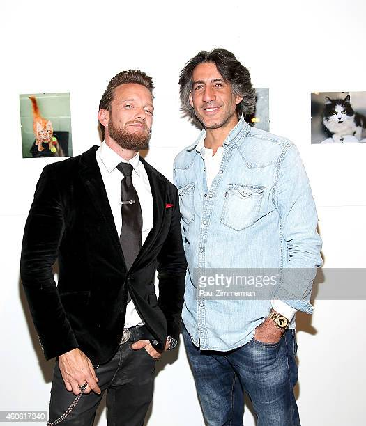 Photographers Jamie McCarthy and Dimitrios Kambouris attend a pet portrait exhibition by Getty Images staff photographer Jamie McCarthy to benefit...